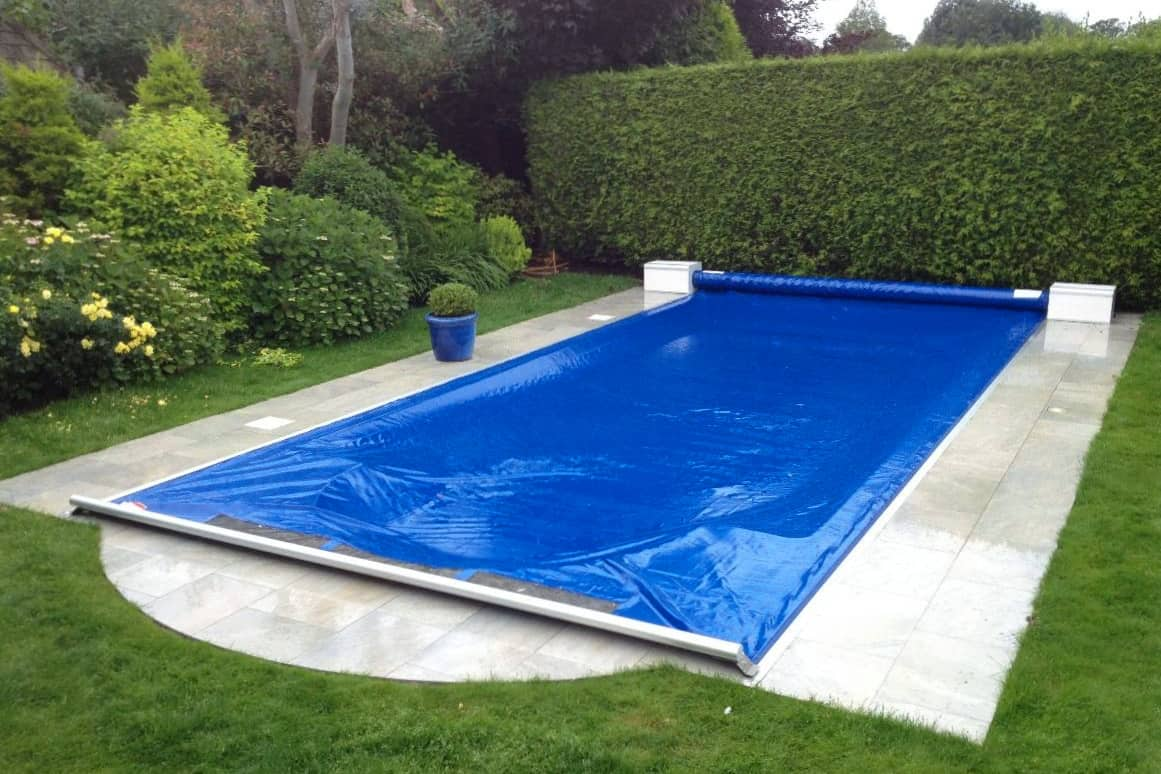 Swimming pool cover over pool