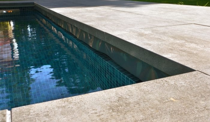 Integrated swimming pool cover