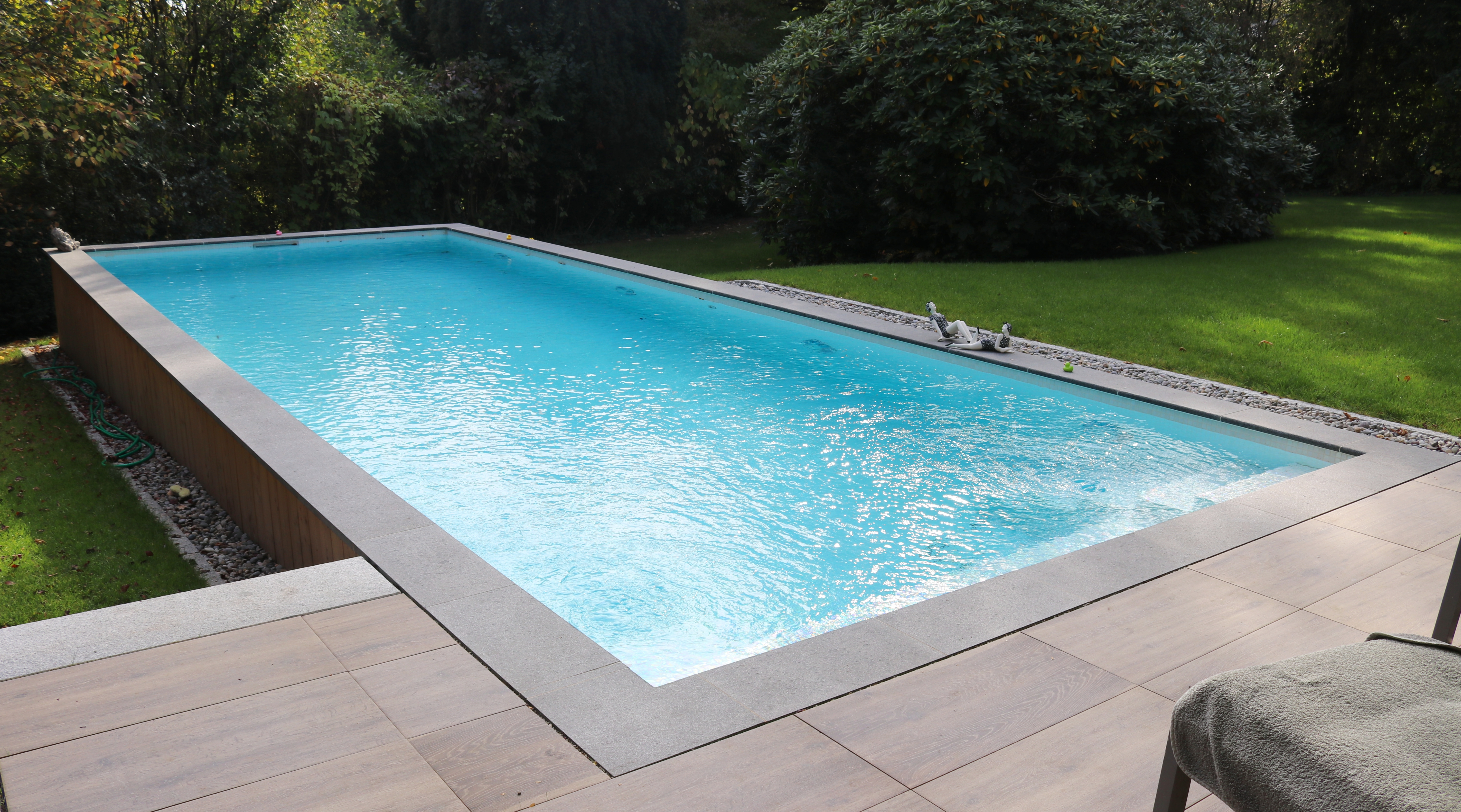 Large tiled swimming pool outside