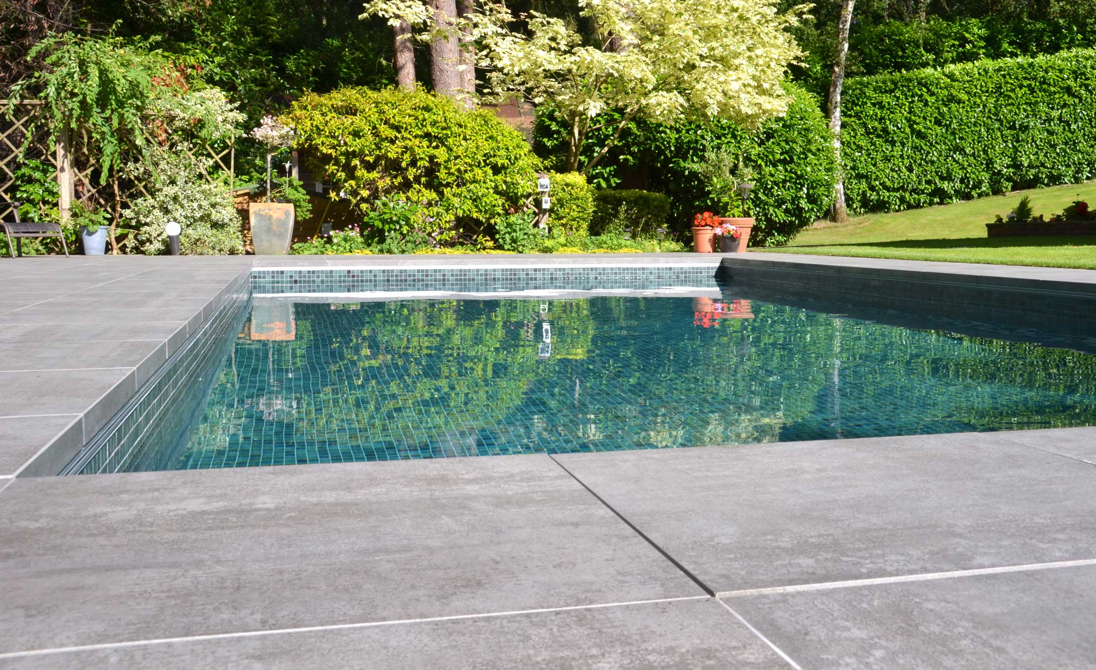 Outdoor tiled swimming pool in ground