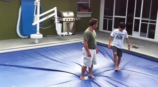 Man stood on pool cover